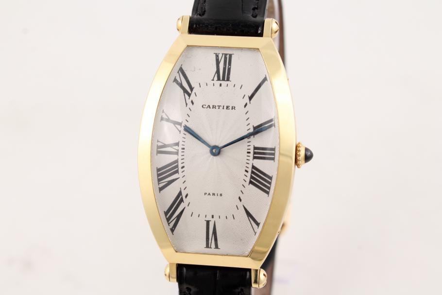 Cartier in 18K Gelbgold am Lederband