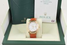 Rolex Datejust Gelbgold am Lederband