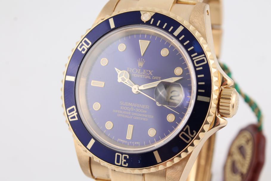 Rolex Submariner in Gelbgold mit allen Unterlagen